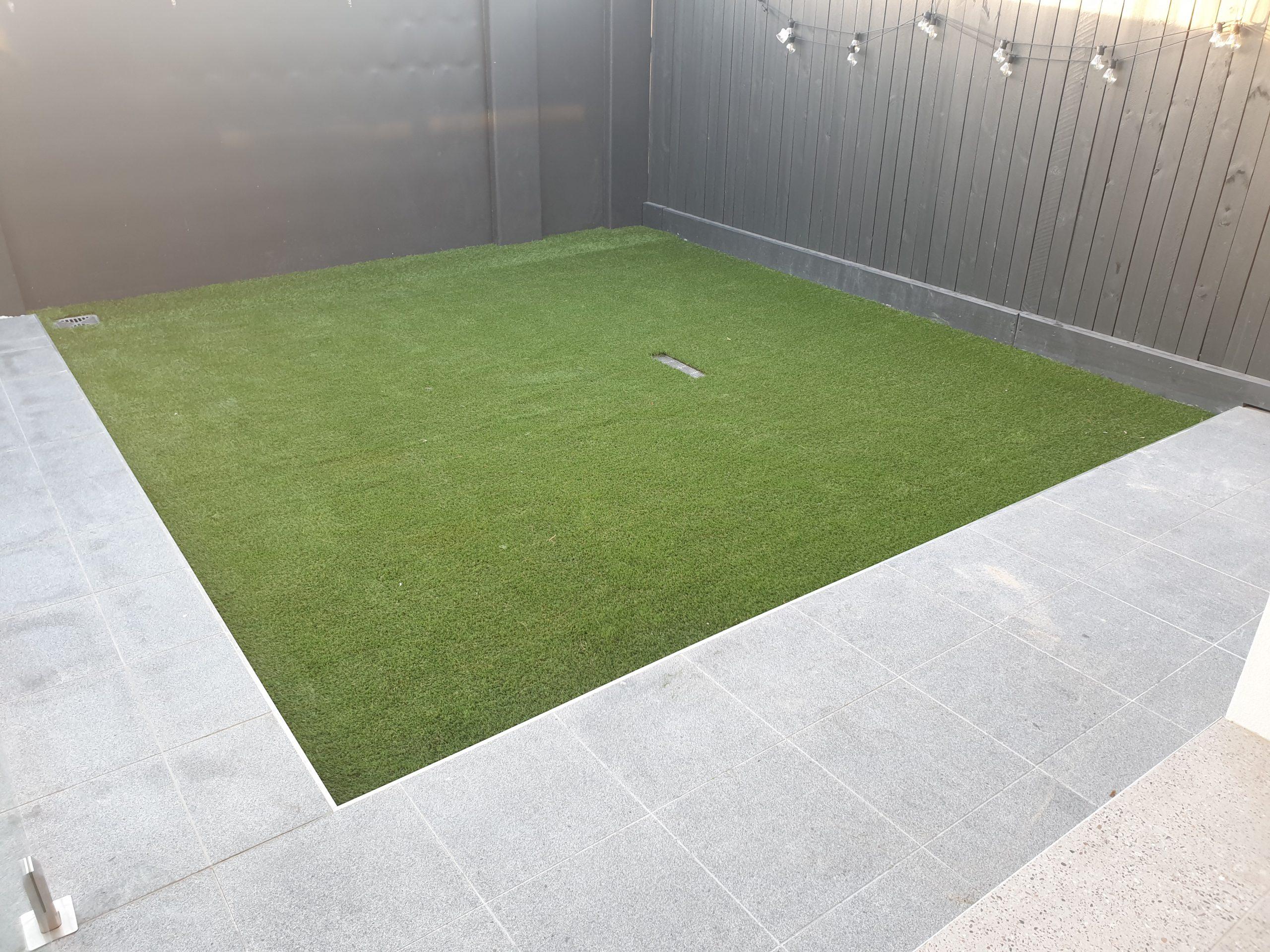 Installation of fake grass, and paving