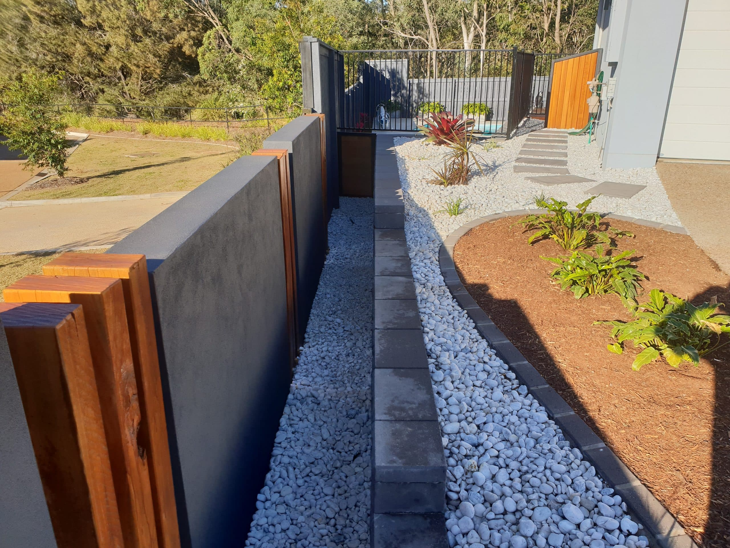 Retaining wall, rock garden and featured plants