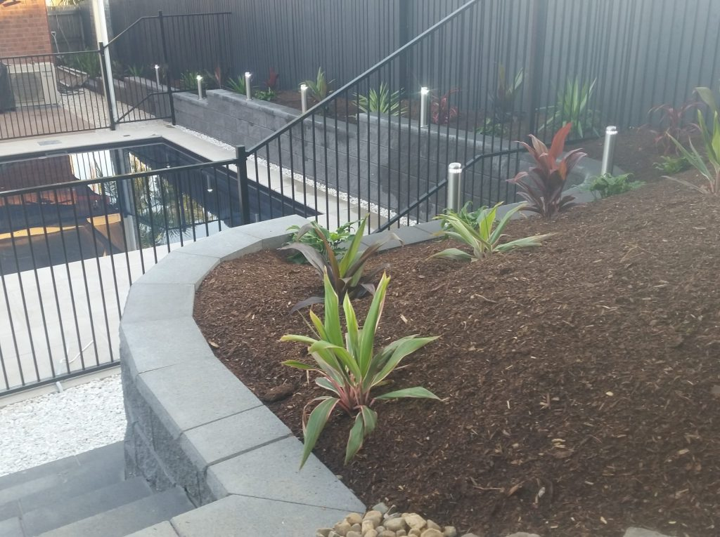 Retaining wall with in-built steps and a feature garden