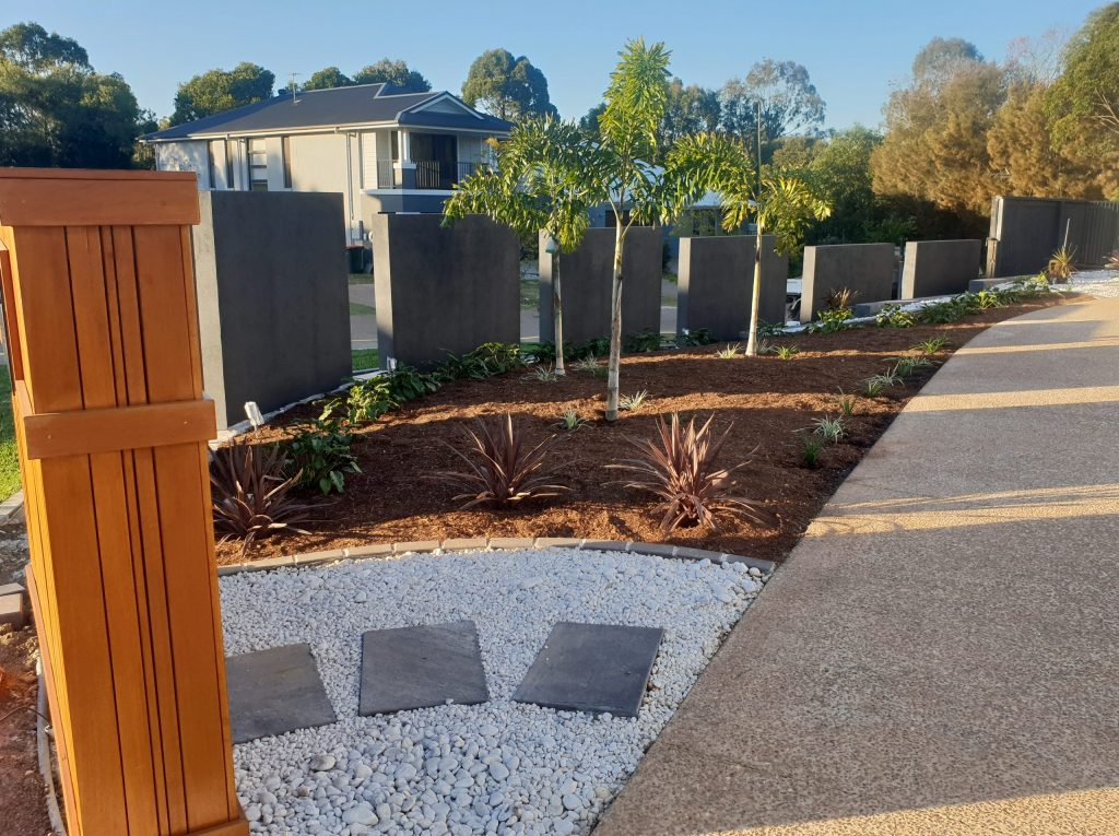 Custom Fencing with rock garden and feature plants