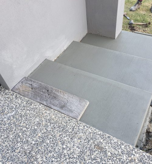 Custom-made timber look concrete steps during construction