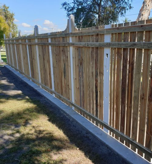 behind the colonial fencing